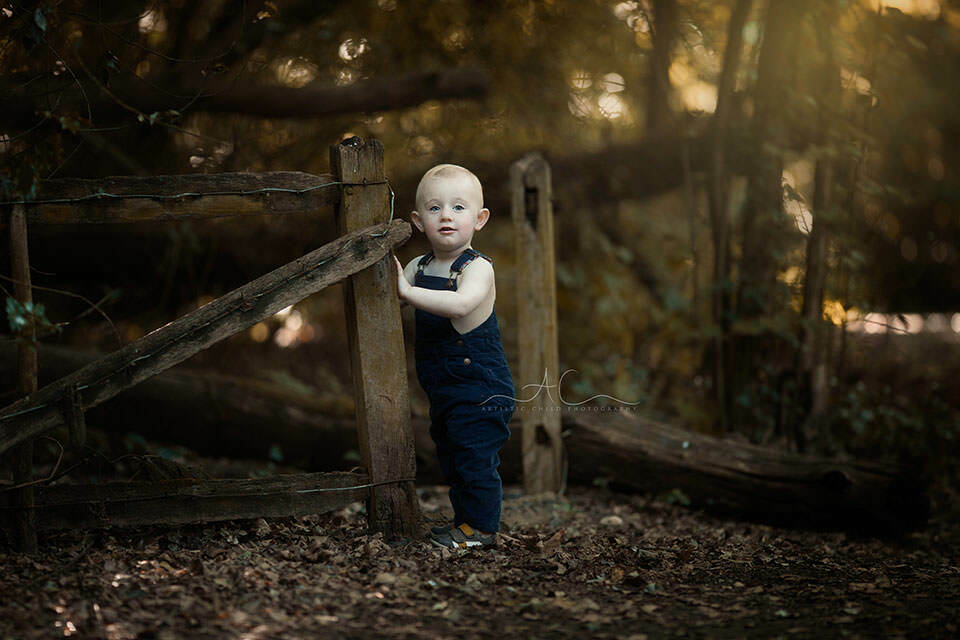 South East London Toddler Photography | 18 months old boy standing next too wooden fence in London park