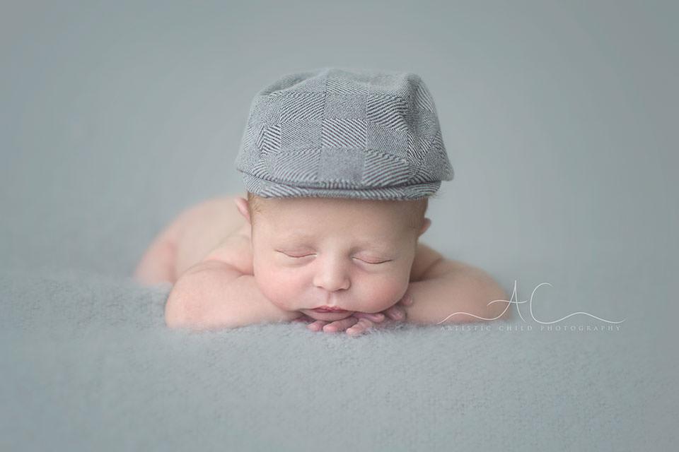 Beautiful London Newborn Images| newborn baby boy wearing a flat cap