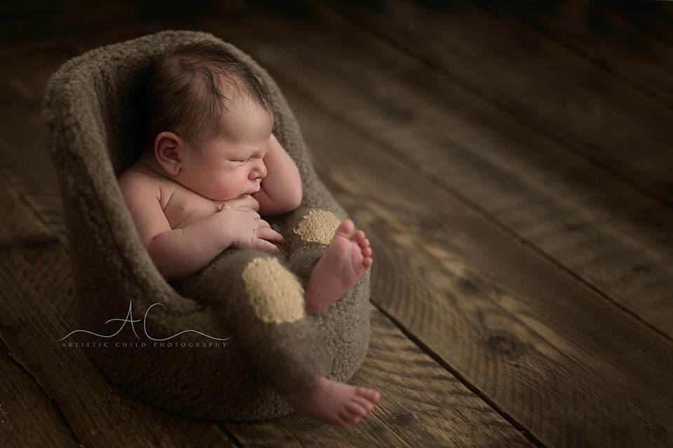 Bromley newborn photography newborn baby boy sleeping in the posing pod