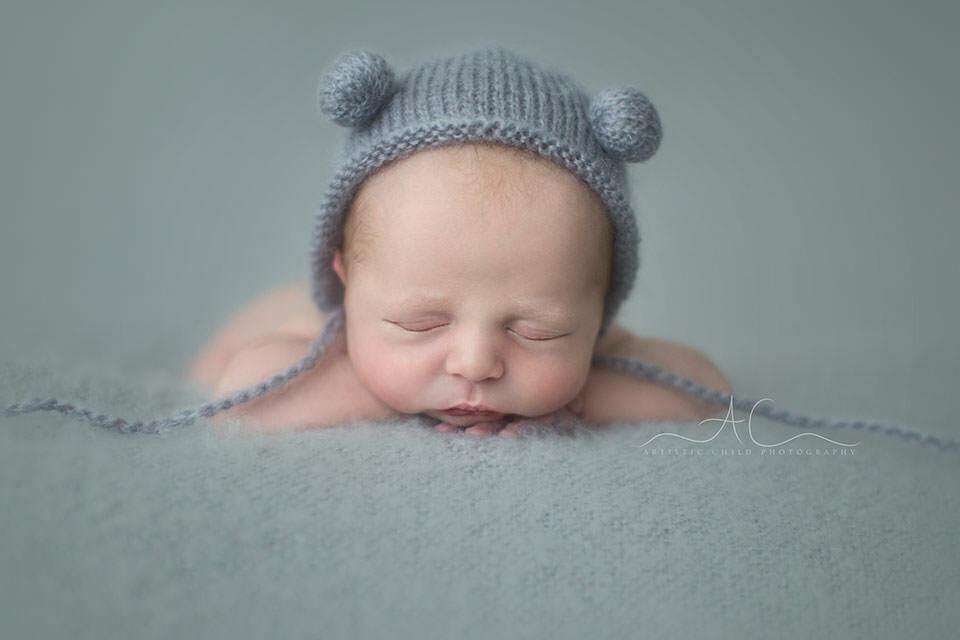 South East London Newborn Images | newborn baby boy in pom pom hat