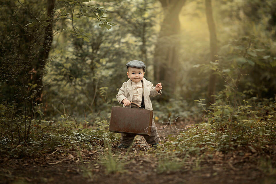 South East London Toddler Photos | 1 year old boy walking with a suitcase in the park