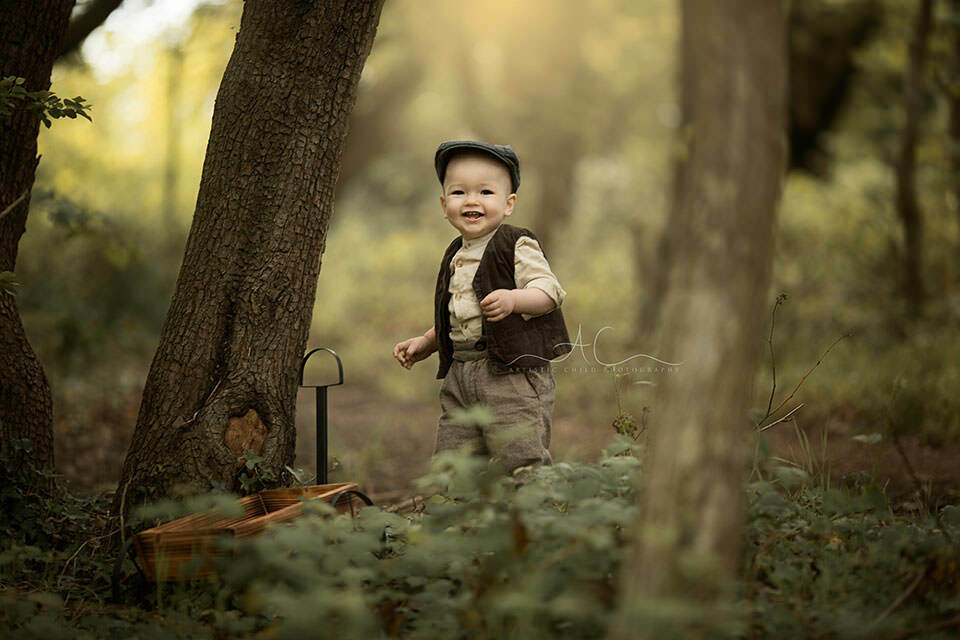 photo of a smily 1 year old boy in flat cap | London