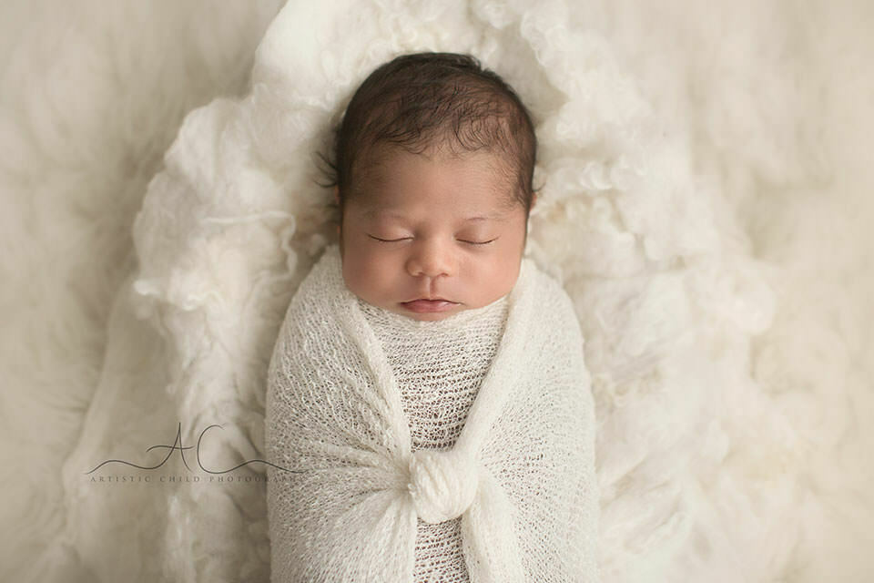newborn baby boy photographed on what soft blanket   London