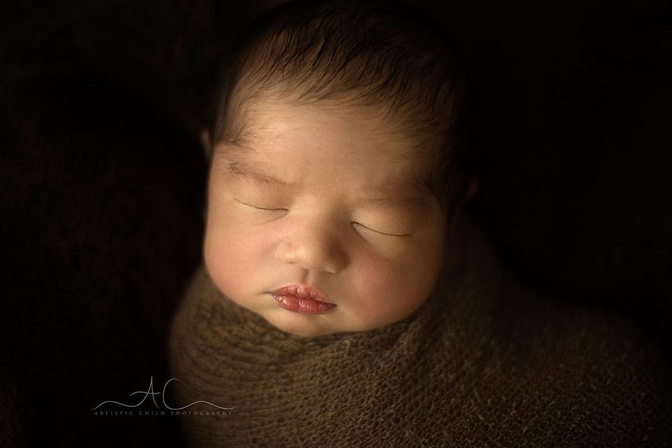 Best London Newborn Portraits | close up portrait of a newborn baby boy face