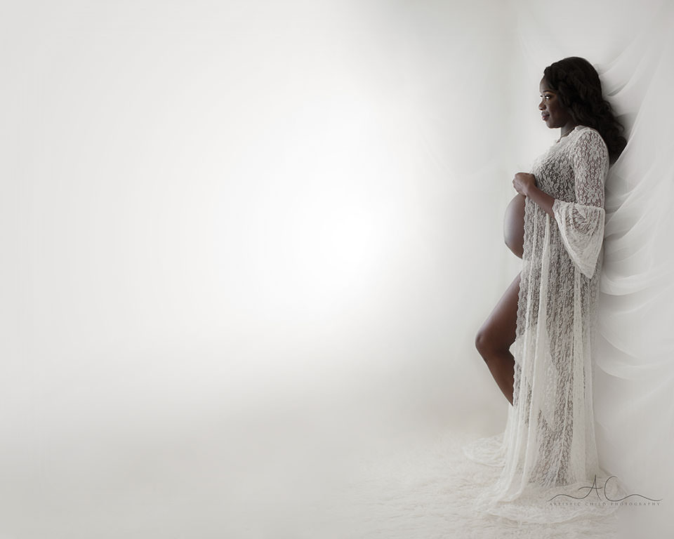 London Maternity Photos | full body portrait of a pregnant woman wearing a lace maternity gown