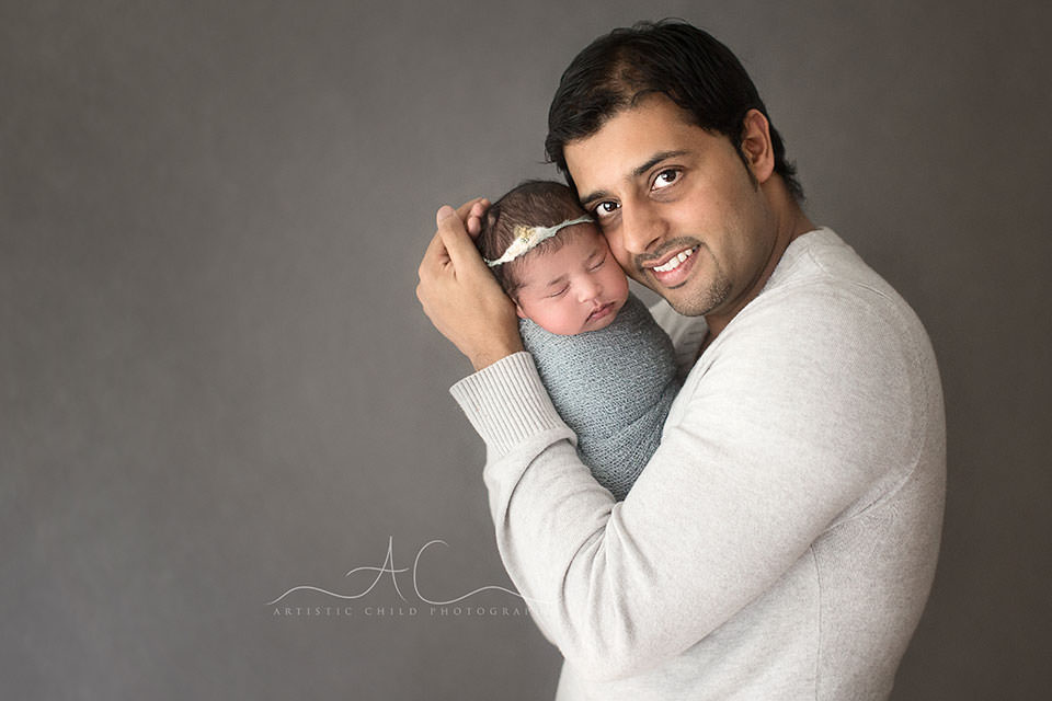 London Family Images | father holding his newborn baby girl