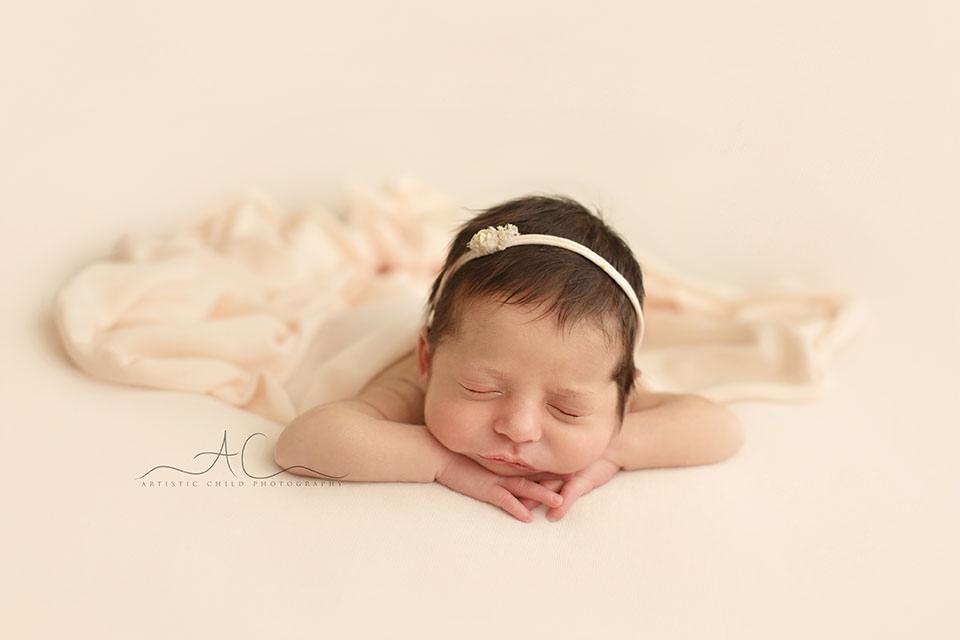 Professional Bromley Newborn Photos   newborn baby girl sleeping in hands under chin position