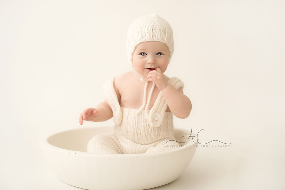 South East London Baby Portraits | 6 months old baby boy sitting in a white wooden bowl