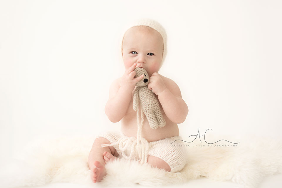 South East London Baby Portraits | 6 months old baby bow chowing on a small teddy bear