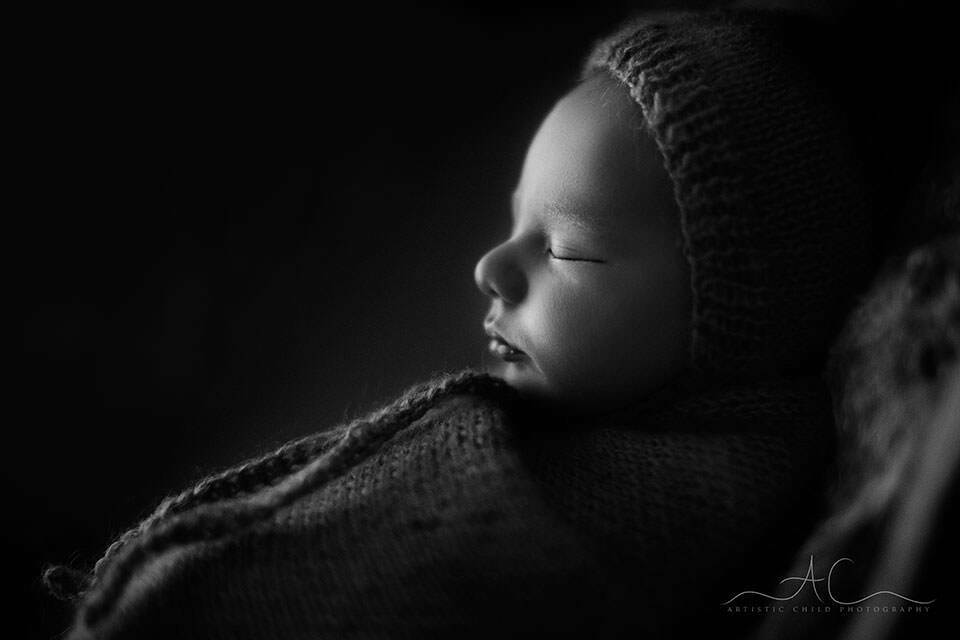 balck and white profile portrait of  newborn baby boy in a hat | London