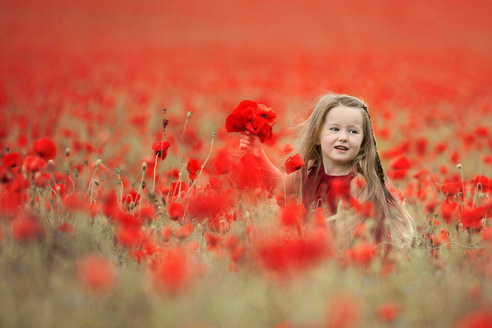 5 year old girl running through a poppy field | London