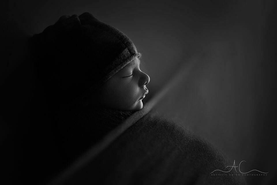 Black and White London Newborn Photos | backlit portrait of newborn baby boy wearing a sleepy hat
