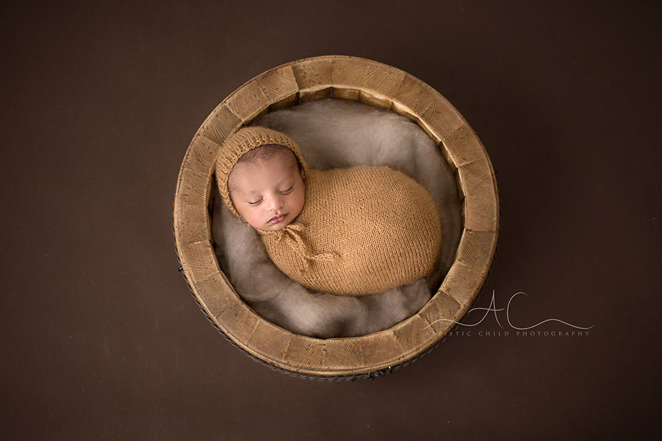 Bromley Newborn Baby Photos   portrait of a newborn baby boy sleeping in a wooden bowl prop