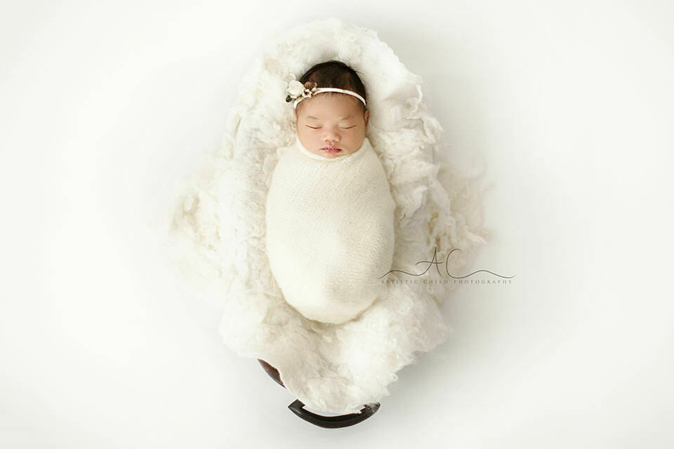 Bromley Newborn Baby Pictures | newborn baby girl swaddled and sleeping in a trench bowl