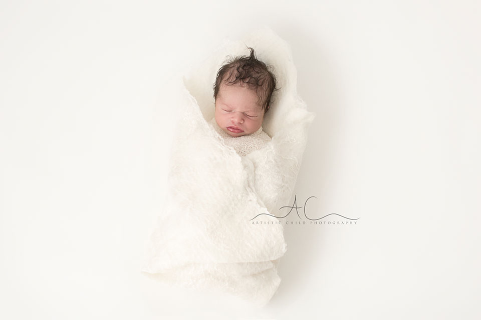 South East London Newborn Baby Boy Photography | newborn baby boy with lots of hair swaddled