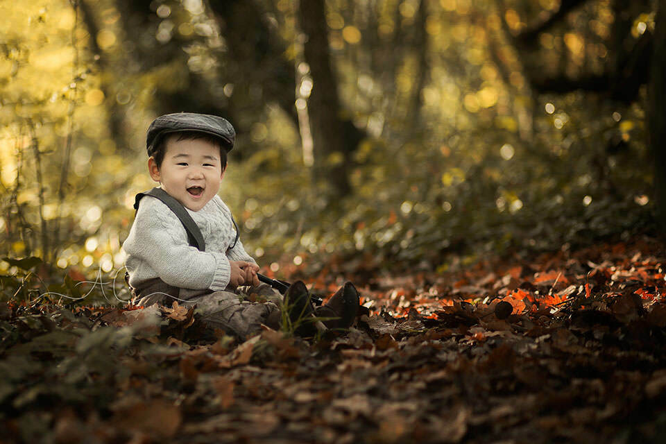 outdoor portrait of 1 year old boy playing happily in the park | London