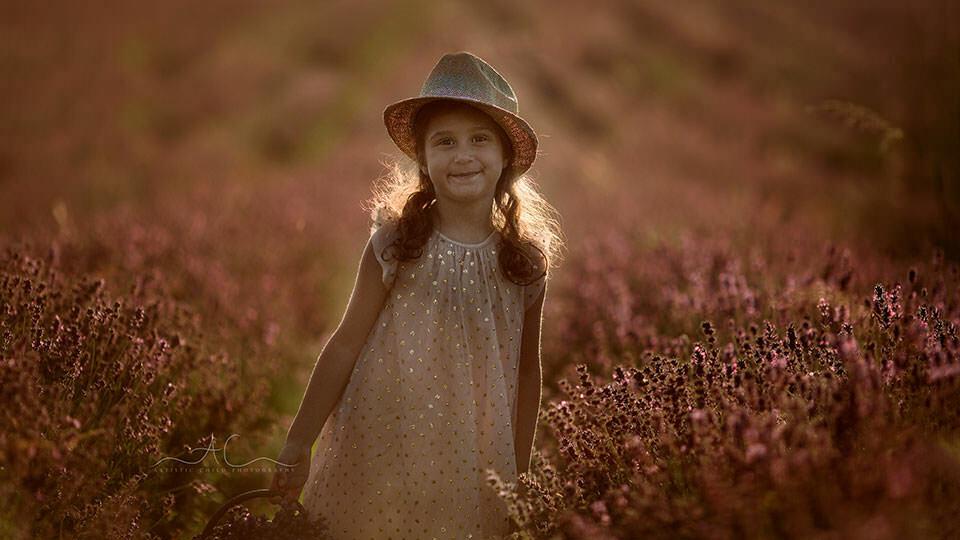 backlit portrait of 5 year old wearing hat in lavender field | London