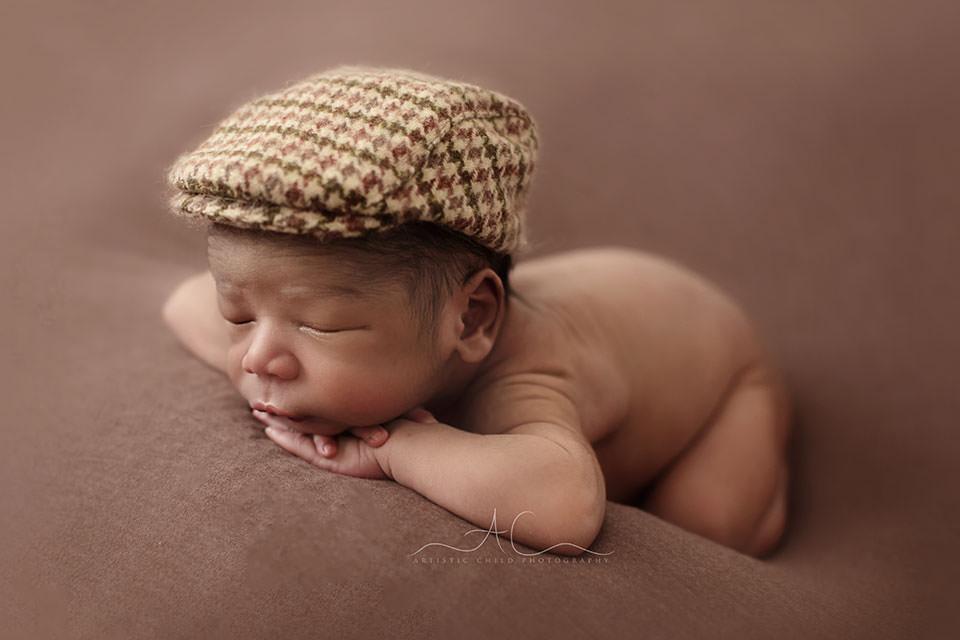 newborn baby boy wearing a flat cap | London