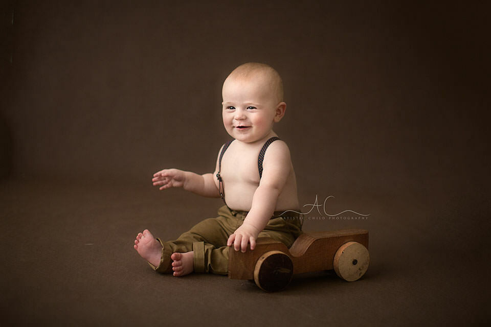 6 months old baby boy smiling during the photo session | London