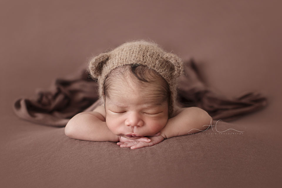 Beautiful London Newborn Pictures | portrait of a newborn baby boy wearing a hand knitted bear hat