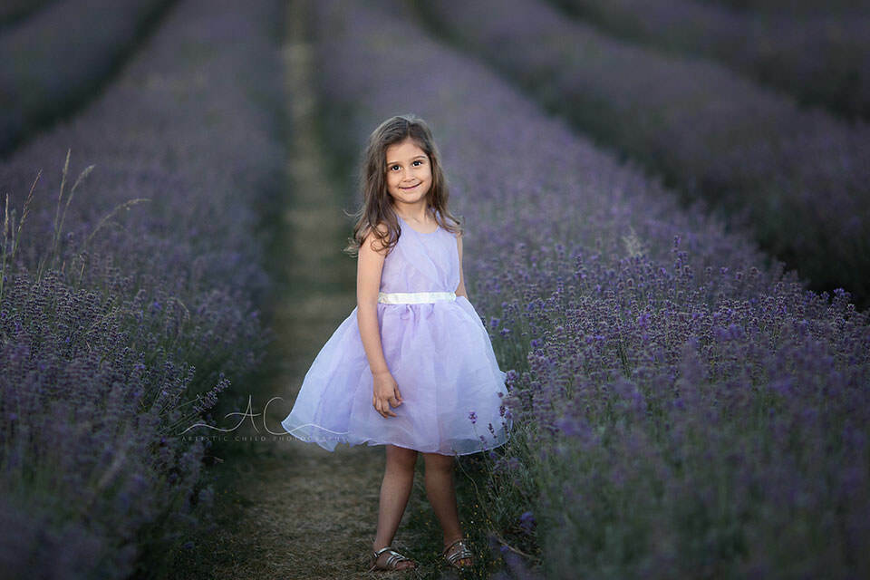 London Kids Pictures in Lavender Field | 5 year old girl smiling for the photo in Lavender field