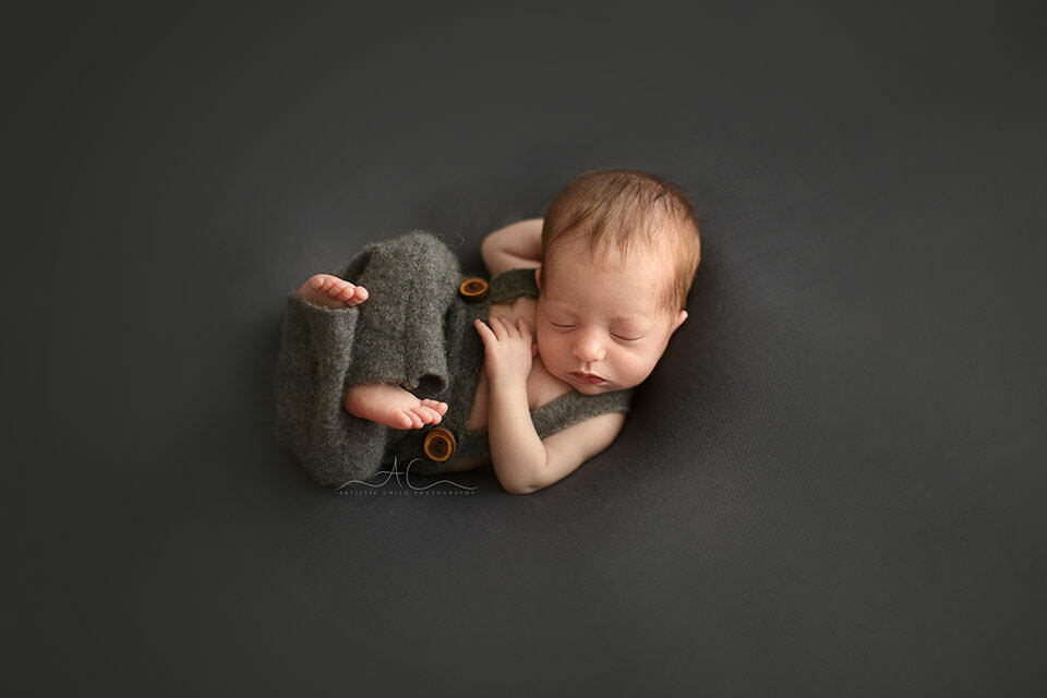 newborn baby boy wearing a cute grey trousers with suspenders | London