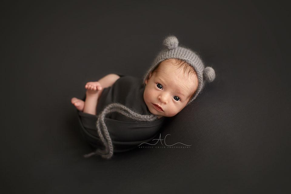 Bromley Newborn Baby Photo Session | newborn baby boy wearing a cute grey bear hat