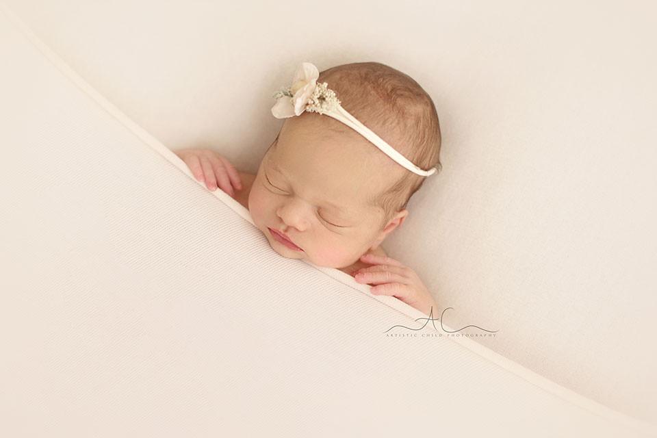 South East London Newborn Baby Girl Photos | newborn baby girl sleeping on her back