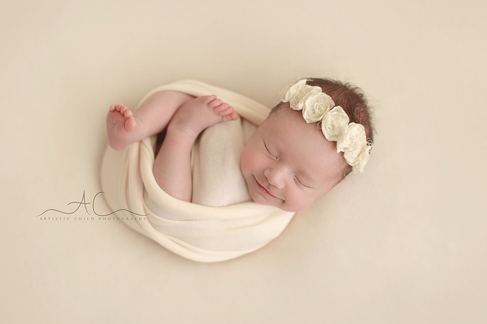 newborn baby girl smiling | London