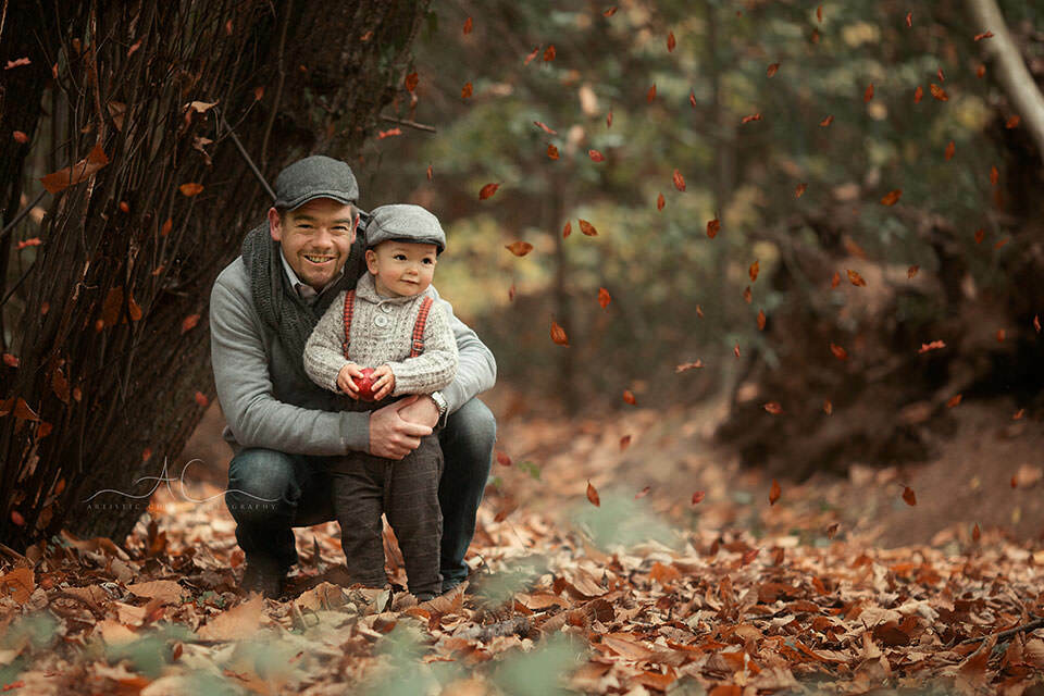 London Family Photography Services | portrait of a father and 18 months old son taken in the park during autumn season
