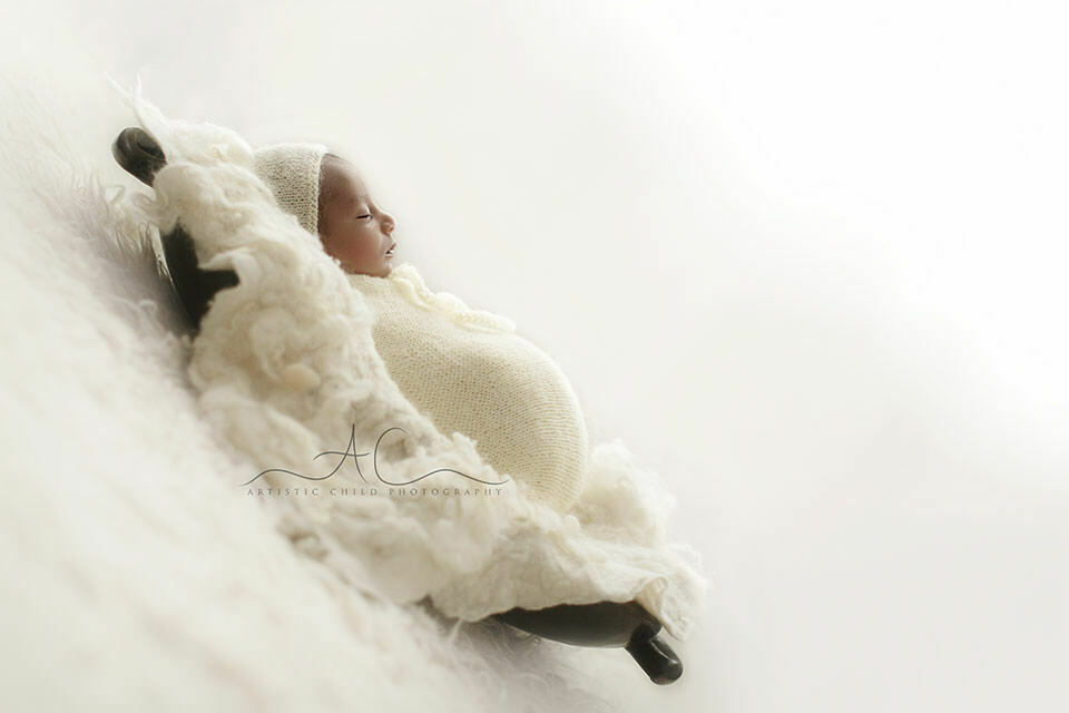 Professional London Newborn Photography Offer | 1 month old baby boy sleeping in a wooden trench bowl