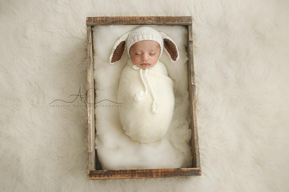 Professional London Newborn Photography Offer | newborn baby boy sleeping in a wooden crate