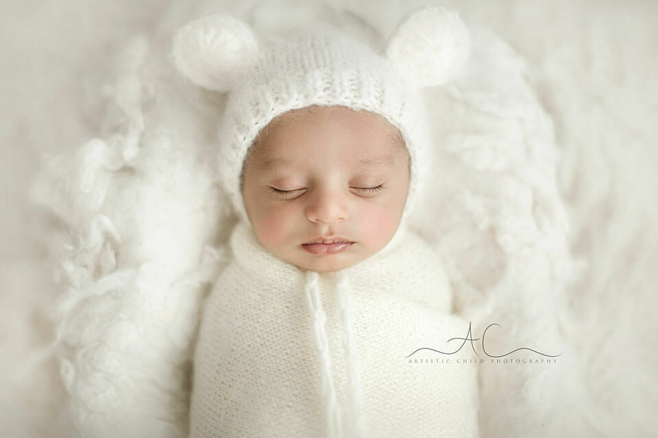 newborn baby boy in a bear ear funny hat | London