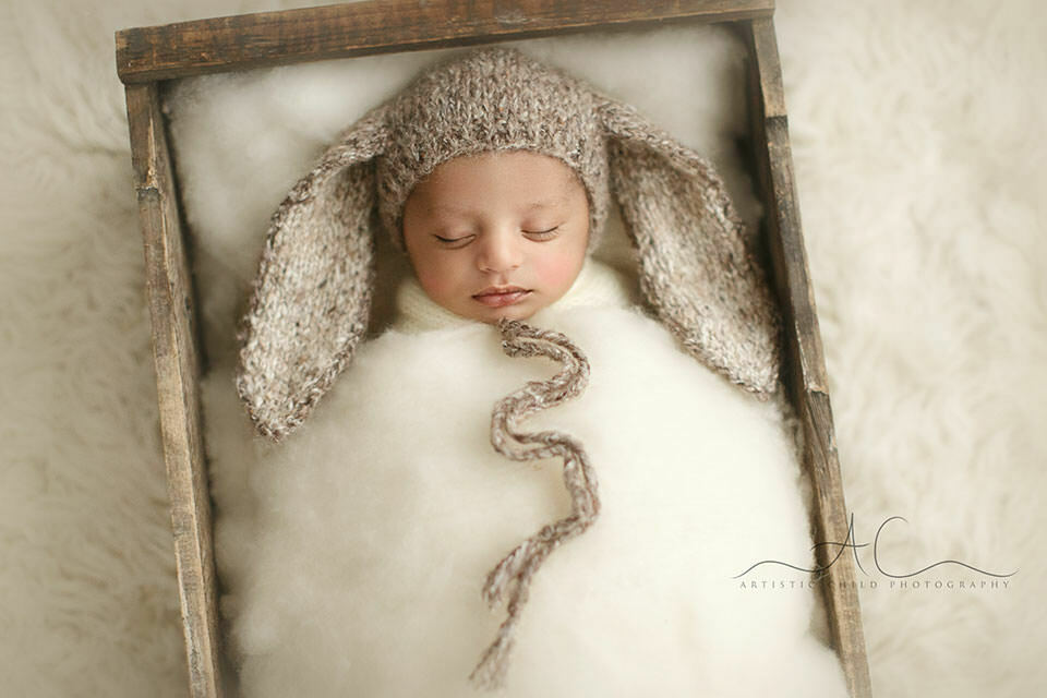 newborn baby boy wearing a funny knitted hat | London