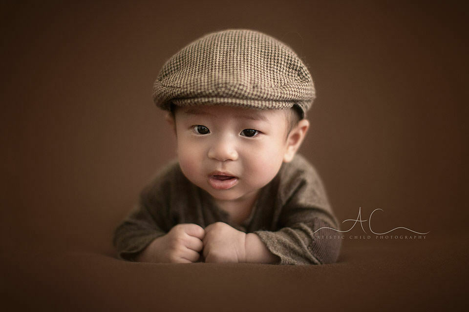 London Baby Boy Photography | 3 months old baby boy wearing a brown flat cap