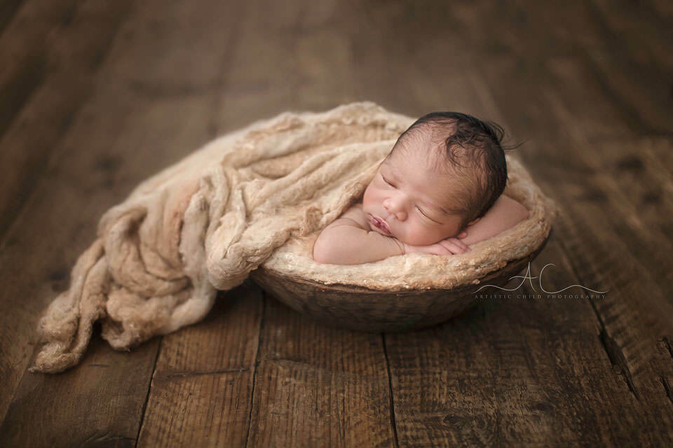 South East London Newborn Photography Offer | newborn baby boy sleeping in wooden bowl