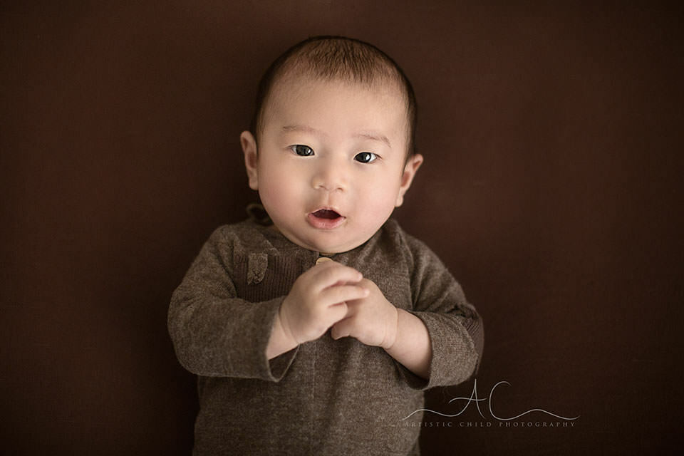 portrait of a 3 months old baby boy making an eye contact | London