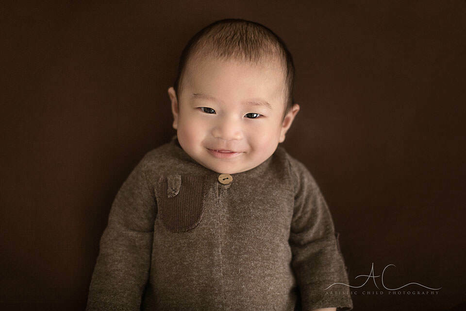 3 months old baby boy making an eye contact and smiling | London