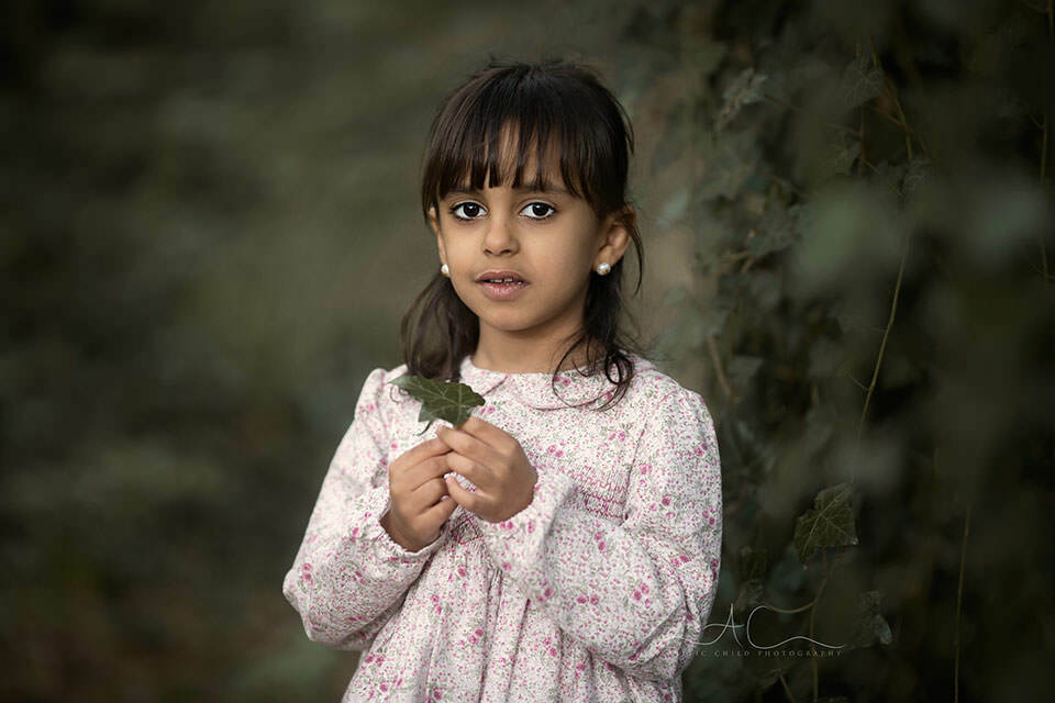 portrait of 5 year old girl holding a leaf | London