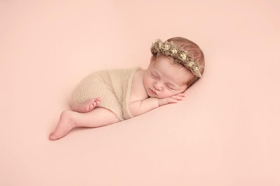 Awesome London Newborn Photos | 3 weeks old newborn baby girl wearing a cute flower halo