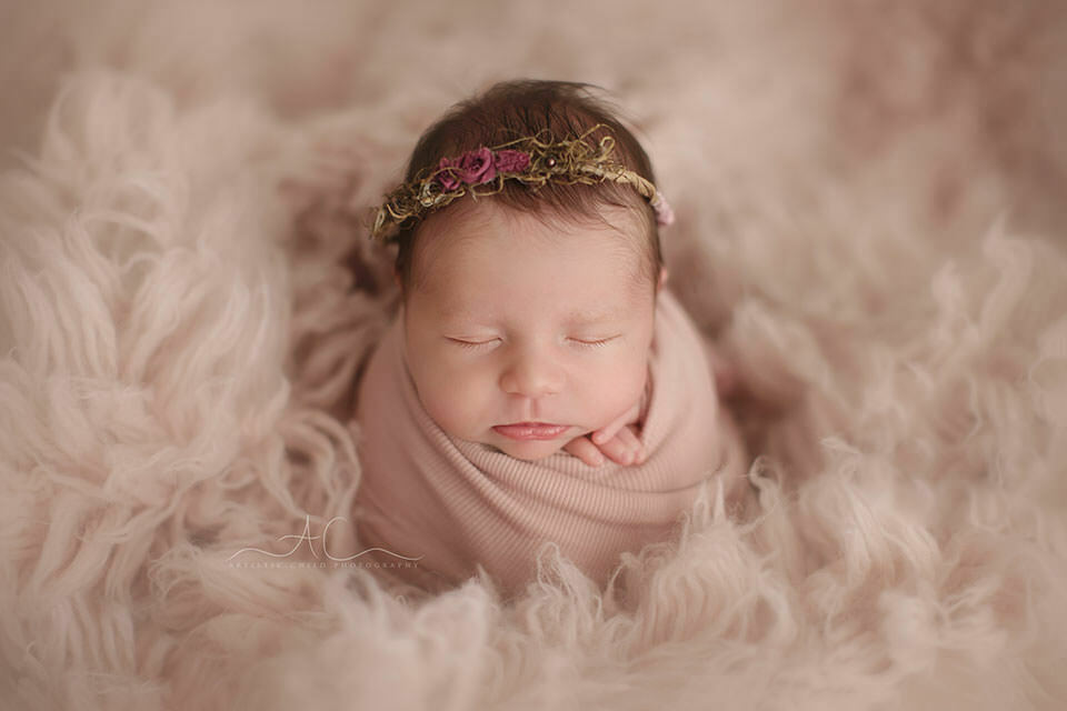 Bromley Newborn Baby Photography Services | newborn baby girl wearing a cute pink flower halo