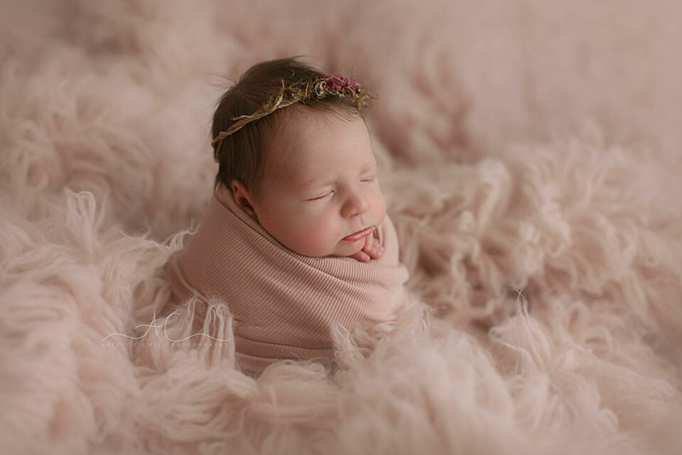 Bromley Newborn Baby Photography Services | newborn baby girl wearing a cute pint bonnet