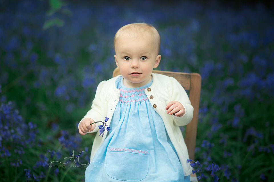 South East London Toddler Photography Services | 12 months old little toddler girl holding a bluebell flower
