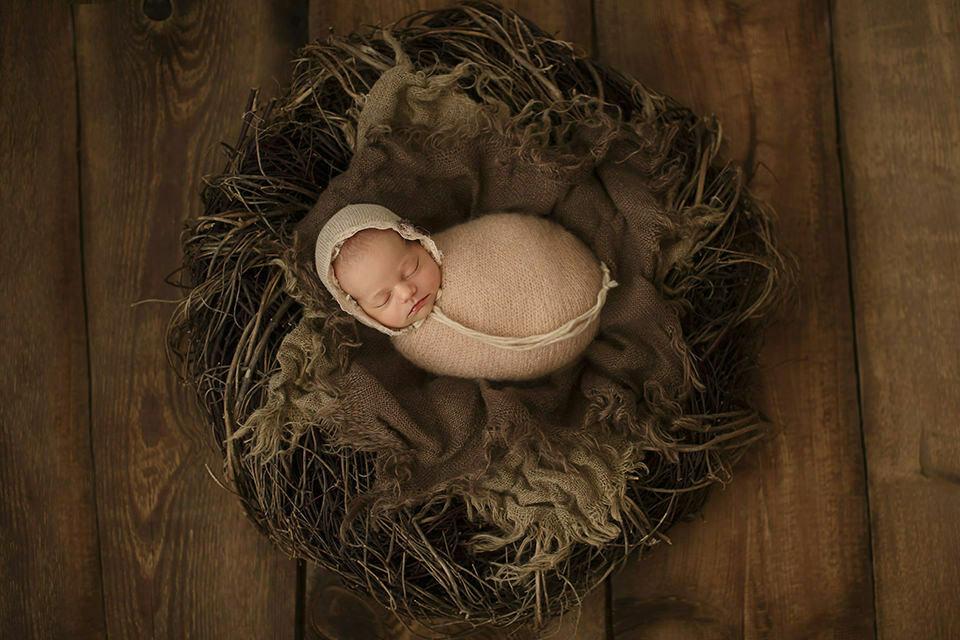Bromley Newborn Baby Photography Offer | newborn baby girl sleeping in a nest prop