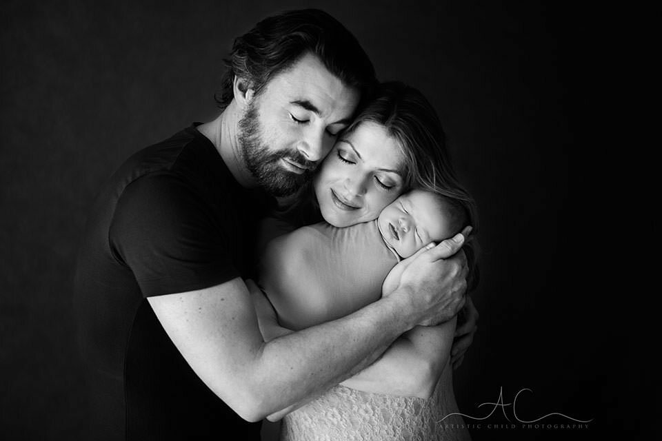 Bromley Family Portraits | black and white portrait of parents holding their newborn son
