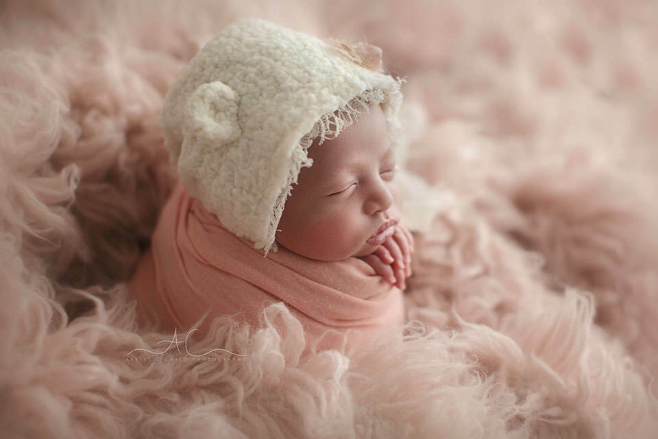 South East London Newborn Baby Girl Images | newborn baby girl wearing a cute bear ear hat
