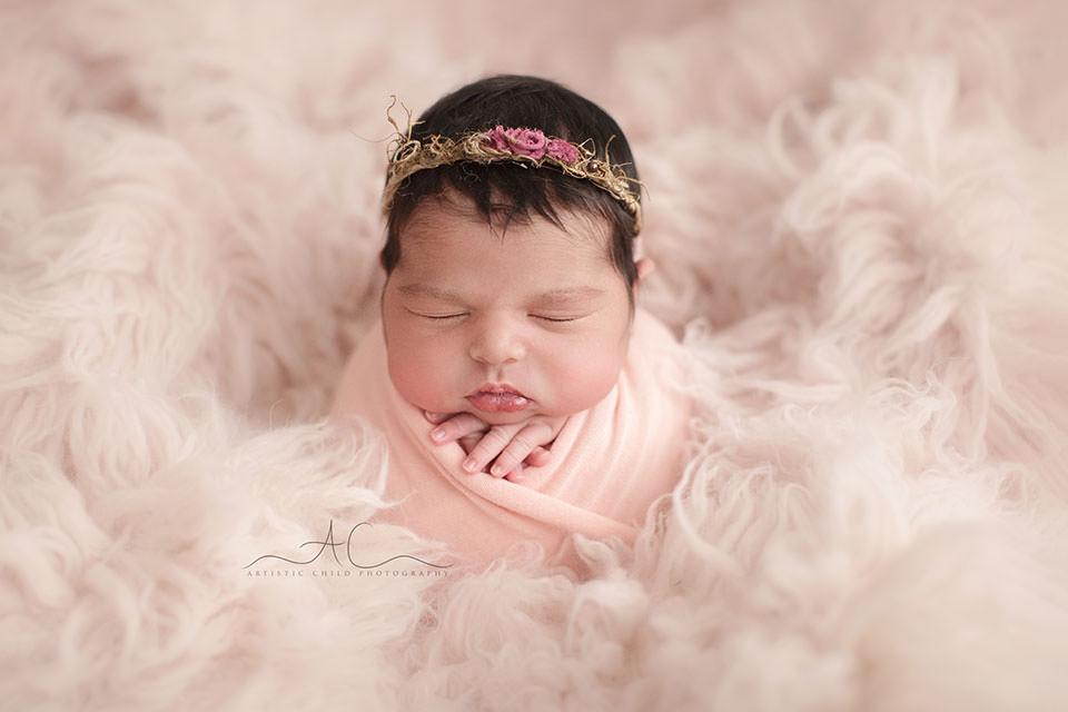 Professional Bromley Newborn Portraits | newborn baby girl photographed on a pink flokati