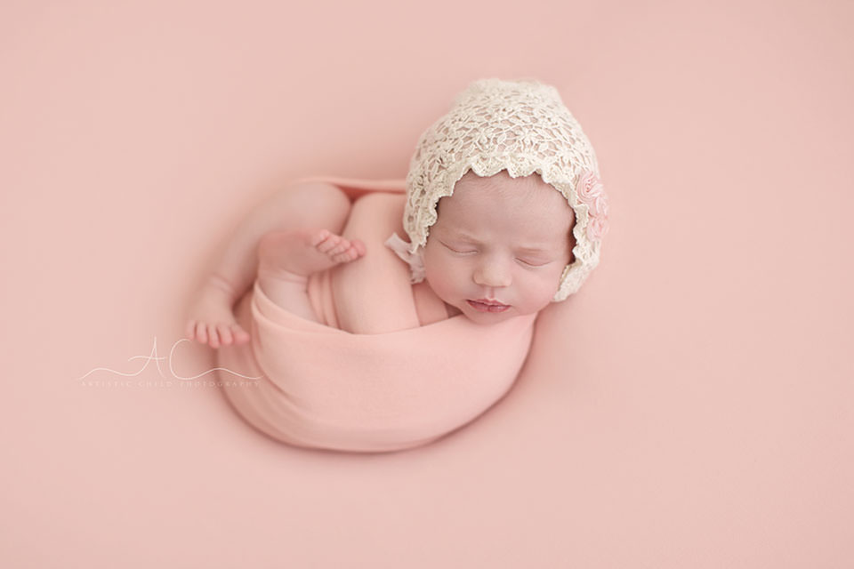 South East London Newborn Baby Girl Pictures | newborn girl wearing a pretty white bonnet