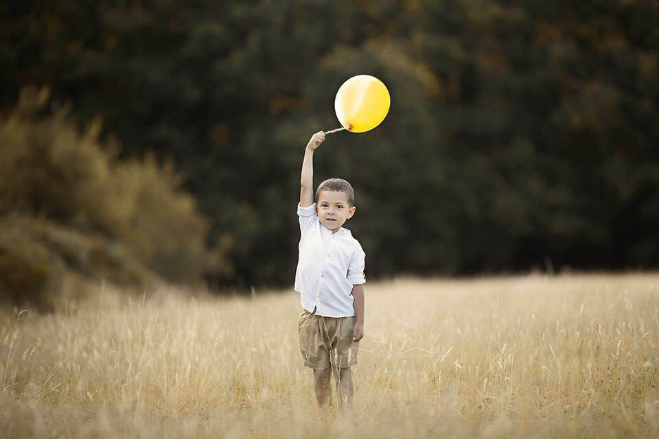 portrait of a 5 year old boy with a yellow baloon | London