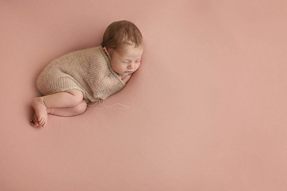 newborn baby girl sleeping peacefully during her photo session   London